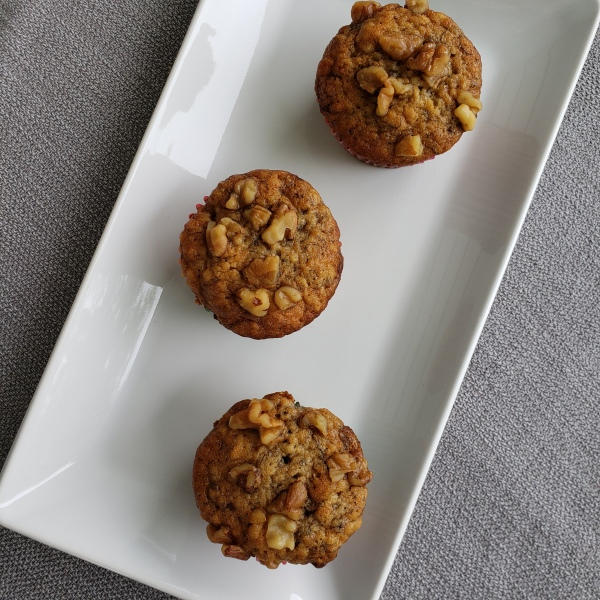 Three muffins on a white dish